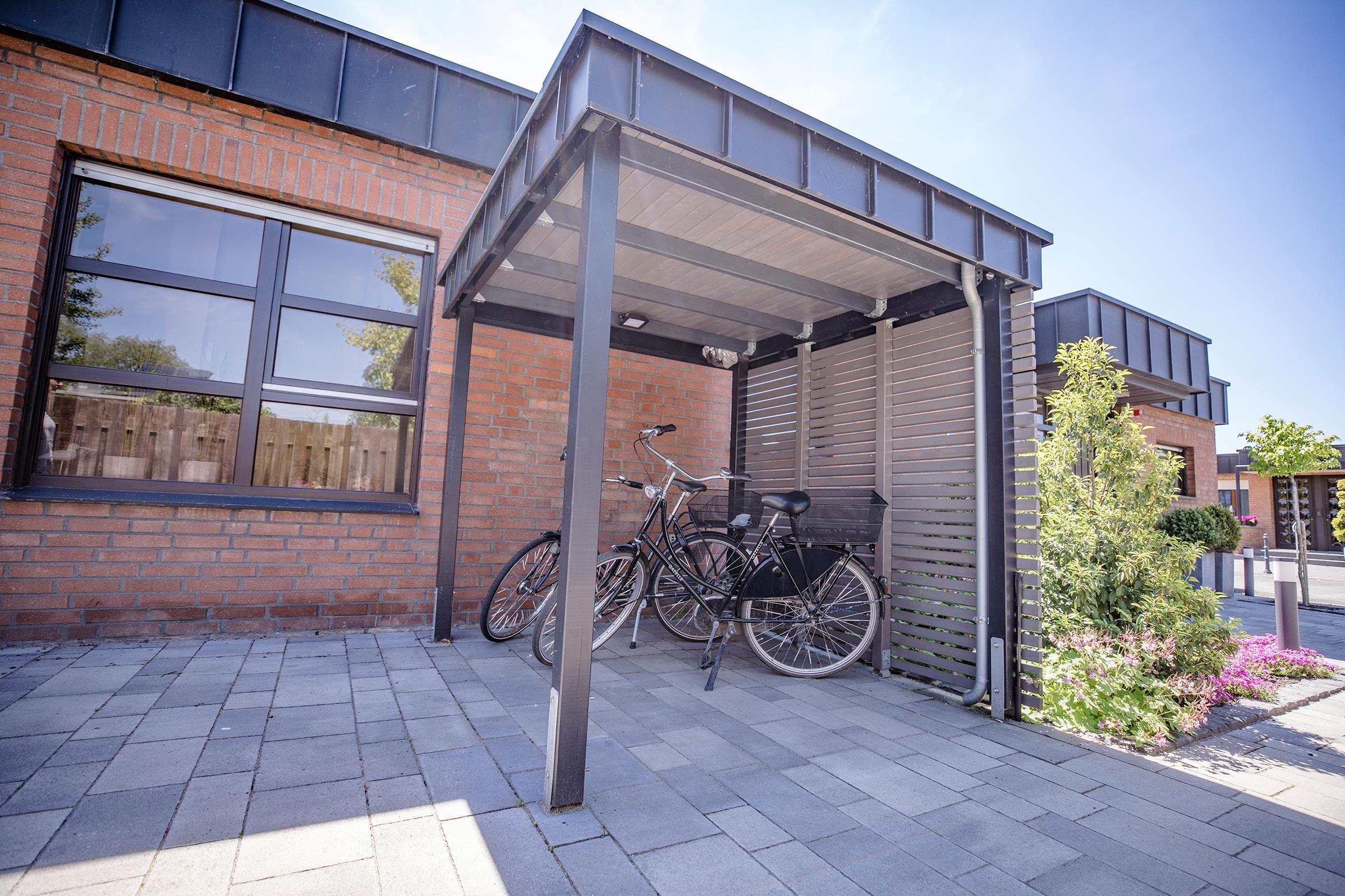 Link zur Bilddatei: Schulze-Tertilt_Referenzen_bungalow_fahrrad_unterstand